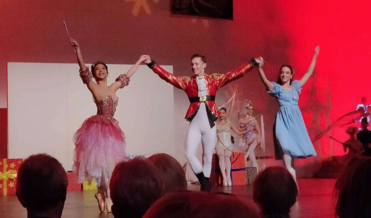 The Sugarplum Fairy, Prince and Clara dance across the stage. The background is now red.