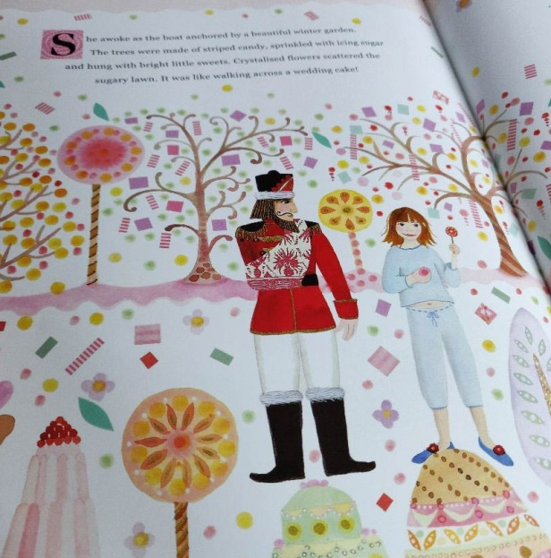 The Nutcracker book opened at a page featuring the Prince and Clara in the Land of Sweets