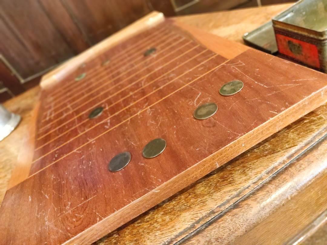 A wooden shove ha'penny board