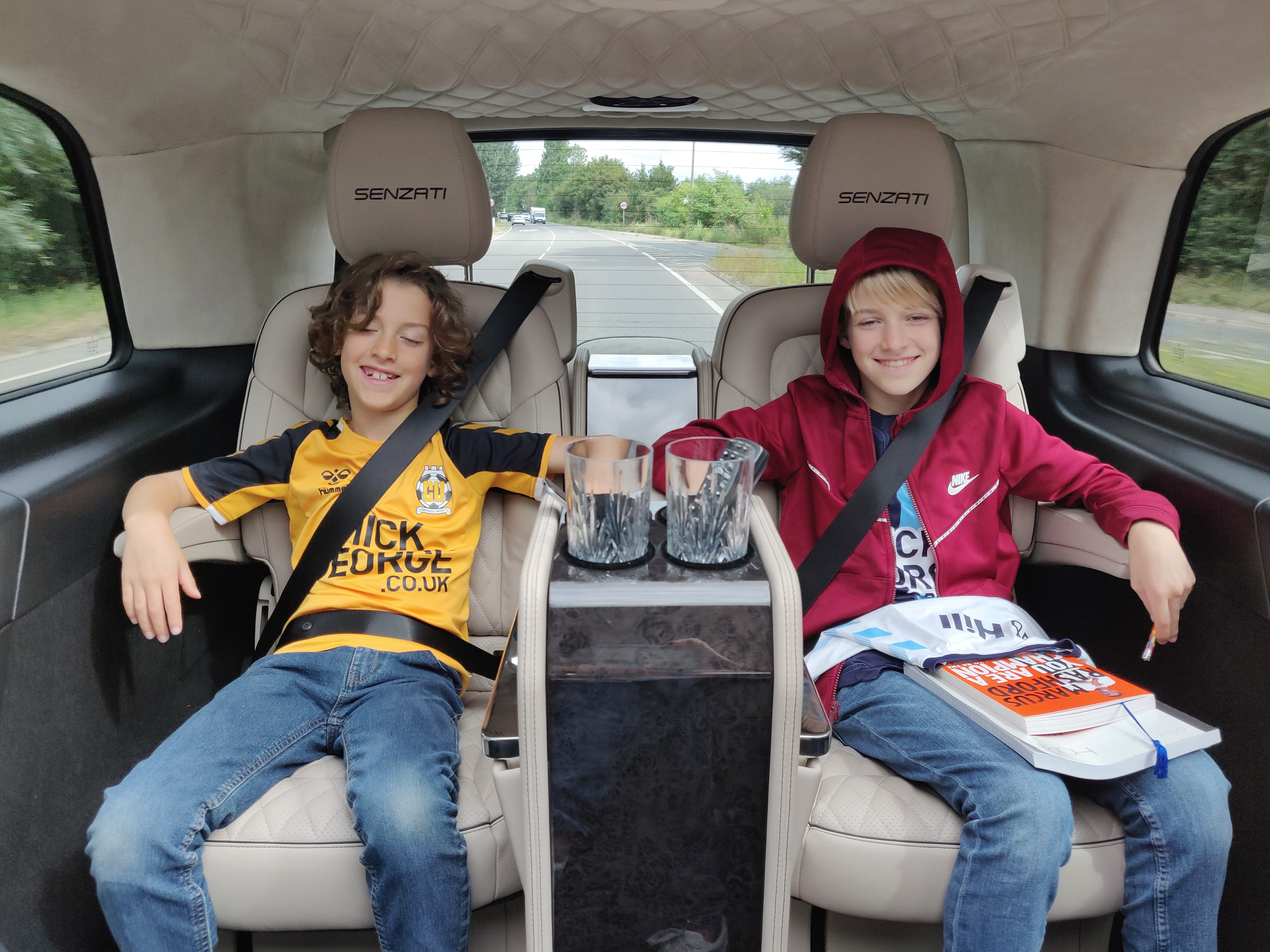 Boys enjoying a relax in the back of the car